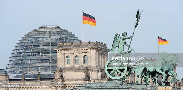 Reichstag Dome And Brandenburg Gate Against Sky