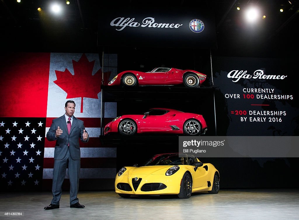 Reid Bigland President and CEO of Alfa Romeo North America reveals the new Alfa Romeo 4C Spider convertible to the media at the 2015 North American...