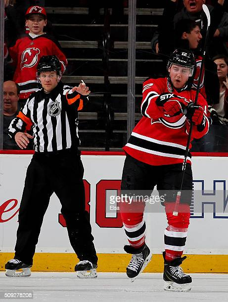 Reid Boucher of the New Jersey Devils celebrates his game winning goal in the third period against the Edmonton Oilers on February 9 2016 at...