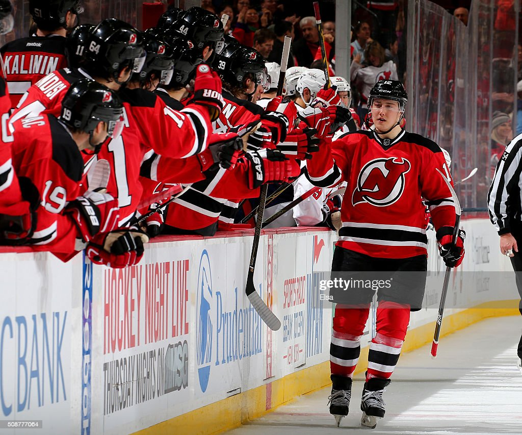 <a gi-track='captionPersonalityLinkClicked' href=/galleries/search?phrase=Reid+Boucher&family=editorial&specificpeople=7895490 ng-click='$event.stopPropagation()'>Reid Boucher</a> #12 of the New Jersey Devils celebrates with teammates on the bench after he scored in the shootout against the Washington Capitals on February 6, 2016 at Prudential Center in Newark, New Jersey.The Washington Capitals defeated the New Jersey Devils 3-2 in an overtime shootout.