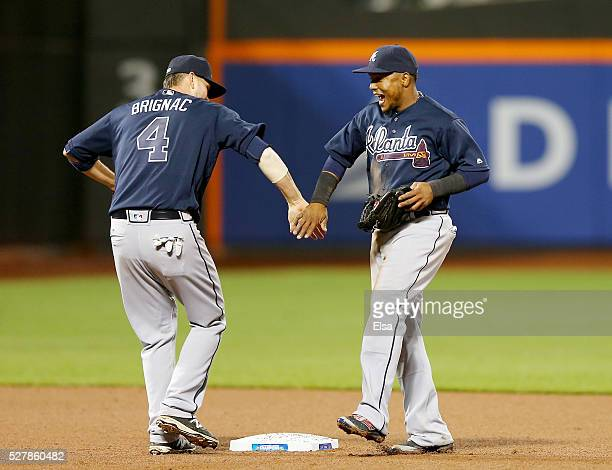 Reid Brignac and Erick Aybar of the Atlanta Braves celebrate the 30 win over the New York Mets at Citi Field on May 3 2016 in the Flushing...