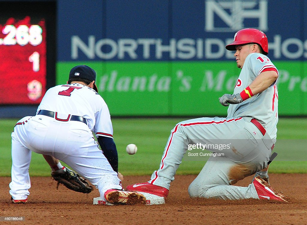 Reid Brignac #17 of the Philadelphia Phillies slides in to second base for a fourth inning double against the Atlanta Braves at Turner Field on June 17, 2014 in Atlanta, Georgia.