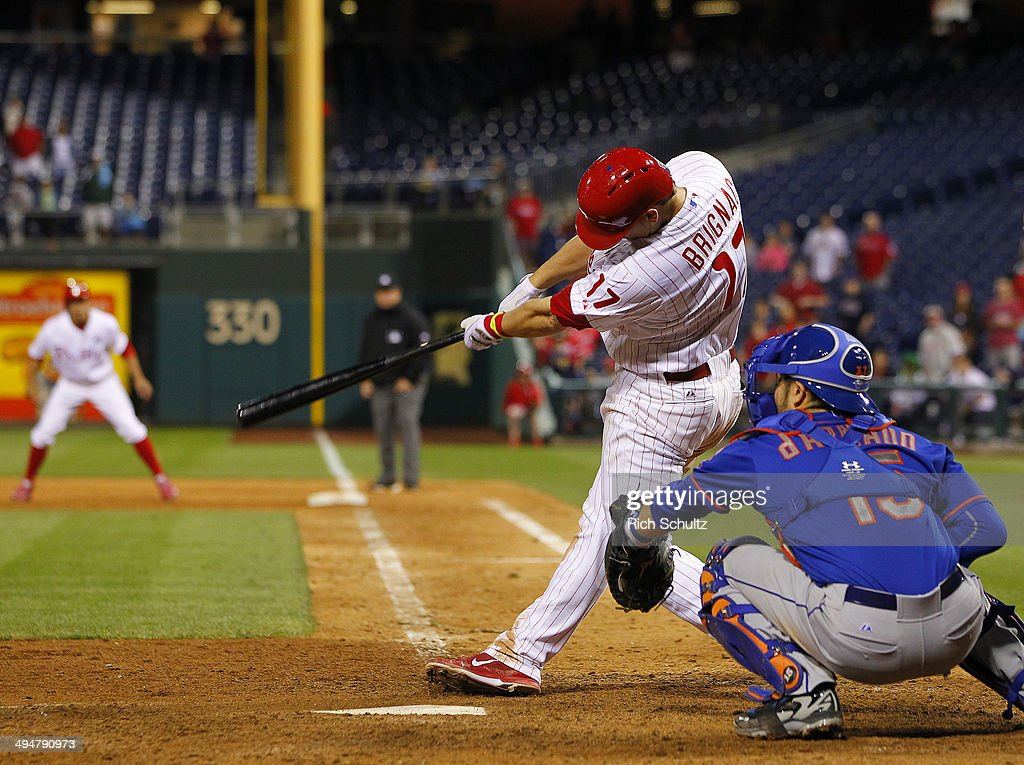 <a gi-track='captionPersonalityLinkClicked' href=/galleries/search?phrase=Reid+Brignac&family=editorial&specificpeople=4175431 ng-click='$event.stopPropagation()'>Reid Brignac</a> #17of the Philadelphia Phillies hits the game winning single in the fourteenth inning to defeat the New York Mets 6-5 during a game at Citizens Bank Park on May 30, 2014 in Philadelphia, Pennsylvania.
