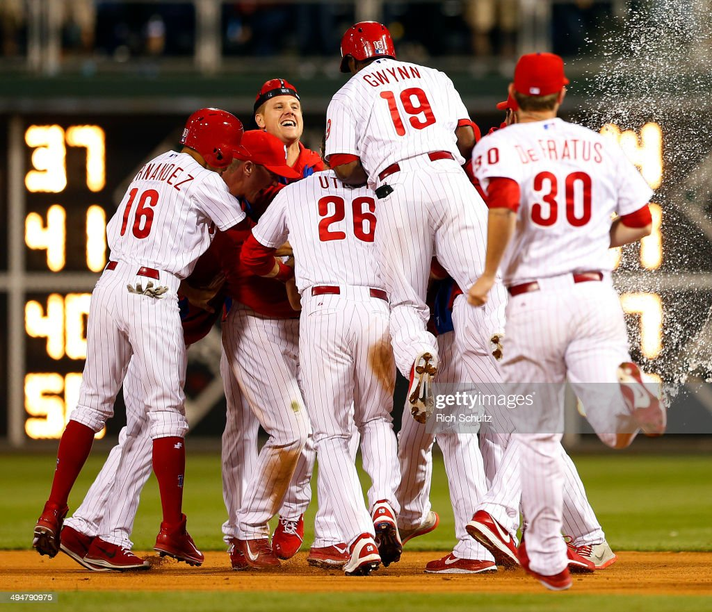 <a gi-track='captionPersonalityLinkClicked' href=/galleries/search?phrase=Reid+Brignac&family=editorial&specificpeople=4175431 ng-click='$event.stopPropagation()'>Reid Brignac</a> #17of the Philadelphia Phillies is mobbed by teammates Cesar Hernandez #16, <a gi-track='captionPersonalityLinkClicked' href=/galleries/search?phrase=Jonathan+Papelbon&family=editorial&specificpeople=453535 ng-click='$event.stopPropagation()'>Jonathan Papelbon</a> #58, <a gi-track='captionPersonalityLinkClicked' href=/galleries/search?phrase=Chase+Utley&family=editorial&specificpeople=161391 ng-click='$event.stopPropagation()'>Chase Utley</a> #26, <a gi-track='captionPersonalityLinkClicked' href=/galleries/search?phrase=Tony+Gwynn+Jr.&family=editorial&specificpeople=206941 ng-click='$event.stopPropagation()'>Tony Gwynn Jr.</a> #19, Justin De Fratus #30 and the rest of the Phillies after hitting the game winning single in the fourteenth inning to defeat the New York Mets 6-5 during a game at Citizens Bank Park on May 30, 2014 in Philadelphia, Pennsylvania.