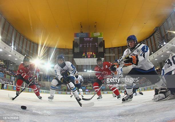 Reid Gardiner Eric Cornel of Canada and Kasperi Kapanen Markus Haapanen of Finland challenged for the puck during the men's semi final ice hockey...