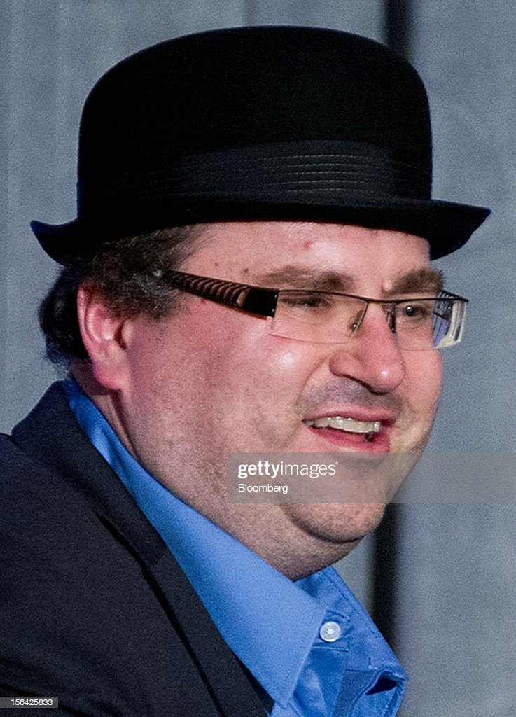 Reid Hoffman, chairman and co-founder of LinkedIn Corp., leaves the stage wearing a hat after speaking during an event at the Churchill Club in Santa Clara, California, U.S., on Wednesday, Nov. 14, 2012. Microsoft Corp. Chief Executive Officer Steve Ballmer said the maker of Windows programs must exploit the opportunity to combine hardware and software as it challenges Apple Inc.'s iPad with the Surface tablet computer. Photographer: David Paul Morris/Bloomberg via Getty Images