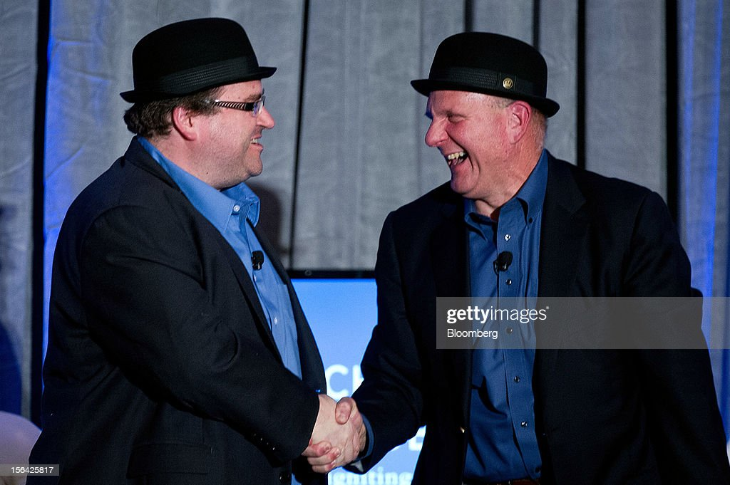 Reid Hoffman, chairman and co-founder of LinkedIn Corp., left, and Steve Ballmer, chief executive officer of Microsoft Corp., leave the stage wearing hats after speaking during an event at the Churchill Club in Santa Clara, California, U.S., on Wednesday, Nov. 14, 2012. Microsoft Corp's Ballmer said the maker of Windows programs must exploit the opportunity to combine hardware and software as it challenges Apple Inc.'s iPad with the Surface tablet computer. Photographer: David Paul Morris/Bloomberg via Getty Images