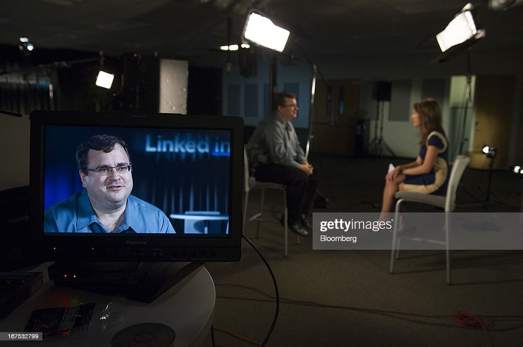 Reid Hoffman, chairman and co-founder of LinkedIn Corp., left, speaks with Bloomberg West anchor Emily Chang during a television interview at the company's headquarters in Mountain View, California, U.S. on Thursday, April 25, 2013. LinkedIn Corp. added publishing platform Pulse, a news-reading application used by more than 20 million people in 190 countries, for news and content this month. Photographer: David Paul Morris/Bloomberg via Getty Images
