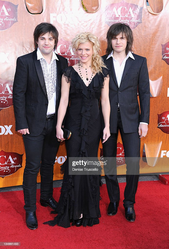 <a gi-track='captionPersonalityLinkClicked' href=/galleries/search?phrase=Reid+Perry&family=editorial&specificpeople=6718326 ng-click='$event.stopPropagation()'>Reid Perry</a>, Kimberly Perry and Neil Perry of The Band Perry arrives at 2011 American Country Awards at MGM Grand Garden Arena on December 5, 2011 in Las Vegas, Nevada.