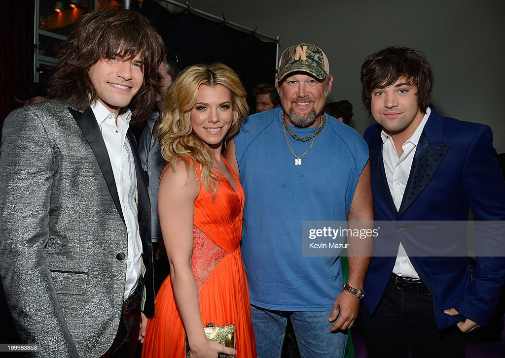Reid Perry, Kimberly Perry, Larry the Cable Guy and Neil Perry attend the 2013 CMT Music awards at the Bridgestone Arena on June 5, 2013 in Nashville, Tennessee.