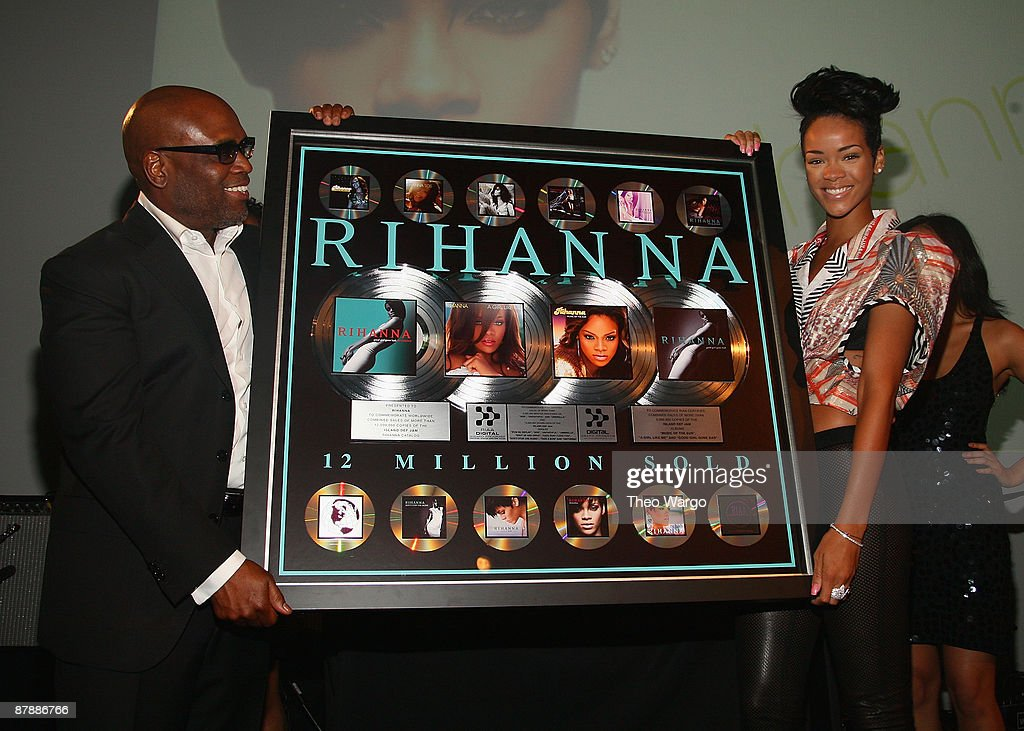 L.A. Reid presents <a gi-track='captionPersonalityLinkClicked' href=/galleries/search?phrase=Rihanna&family=editorial&specificpeople=453439 ng-click='$event.stopPropagation()'>Rihanna</a> with a recording achievement plaque during the Island Def Jam Spring Collection party at Stephen Weiss Studio on May 20, 2009 in New York City.