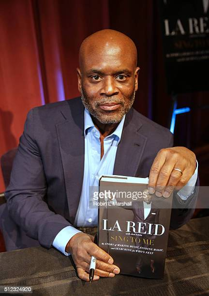 A Reid signs copies of 'Sing To Me' at Morehouse College Ray Charles Performing Arts Center on February 25 2016 in Atlanta Georgia