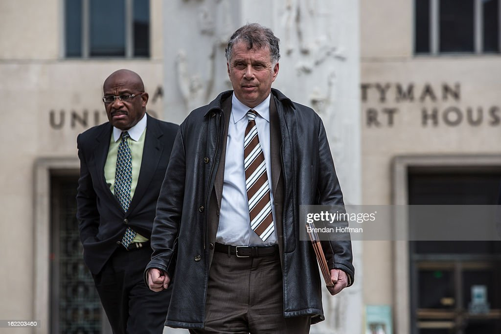 Reid Weingarten (wearing a striped tie), the attorney for former Congressman Jesse Jackson, Jr. and his wife, former Chicago alderman Sandi Jackson, leaves the U.S. District Court for the District of Columbia on February 20, 2013 in Washington, DC. Both Jacksons are expected to plead guilty to federal charges of spending more than $750,000 in campaign cash on personal expenses.
