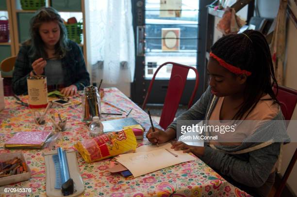 Reign Patton works on decorating a paper box in the theme of Mind Body and Soul during Lil Ladies Teen Art Studio at Violet Hive Art Therapy on April...