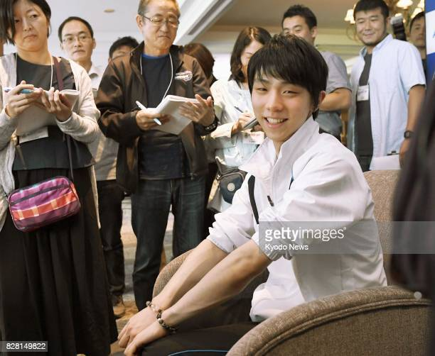 Reigning Olympic figure skating champion Yuzuru Hanyu of Japan meets with reporters in Toronto on Aug 8 to express his enthusiasm for the 2018...