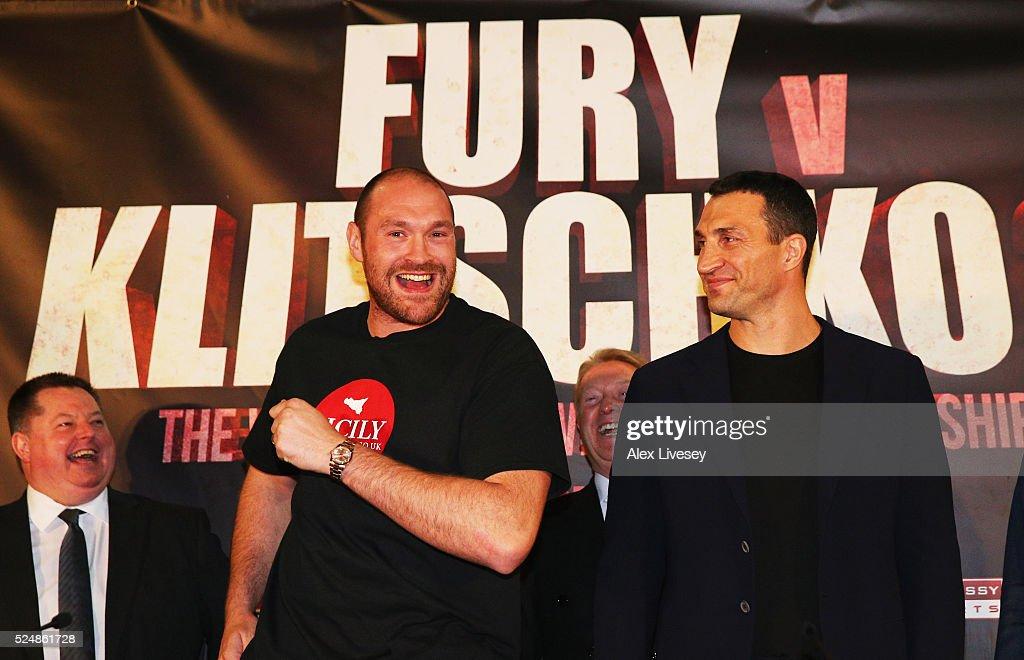 Reigning WBO WBA and IBO heavyweight champion Tyson Fury dances alongside Wladimir Klitschko during Tyson Fury and Wladimir Klitschko head to head...