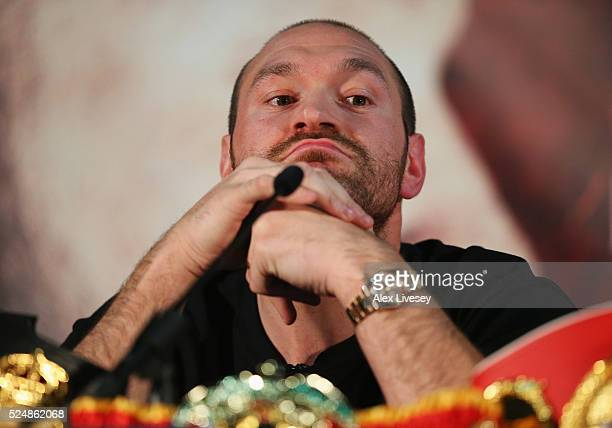 Reigning WBO WBA and IBO heavyweight champion Tyson Fury looks thoughtful during Tyson Fury and Wladimir Klitschko head to head press conference at...