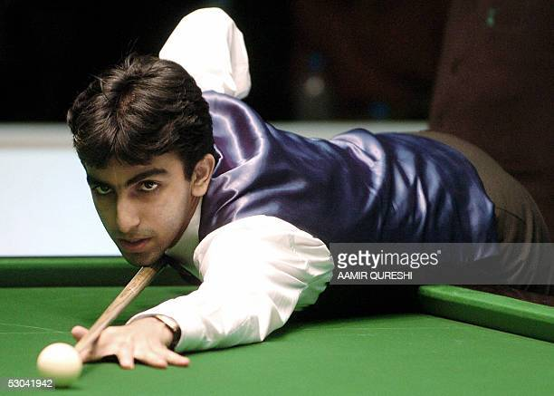 Reigning world billiards champion Pankaj Advani of India prepares to take a shot during his lucky seven match against Pakistani counterpart Imran...