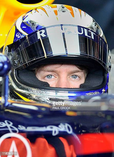 Reigning World Champion Red BullRenault driver Sebastian Vettel of Germany sits in the cockpit of his race car in the leadup to Formula One's...