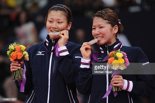 Reika Kakiiwa and Mizuki Fujii of Japan stand on the podium with their Silver medals following the Women's Doubles Badminton Gold Medal match on Day...