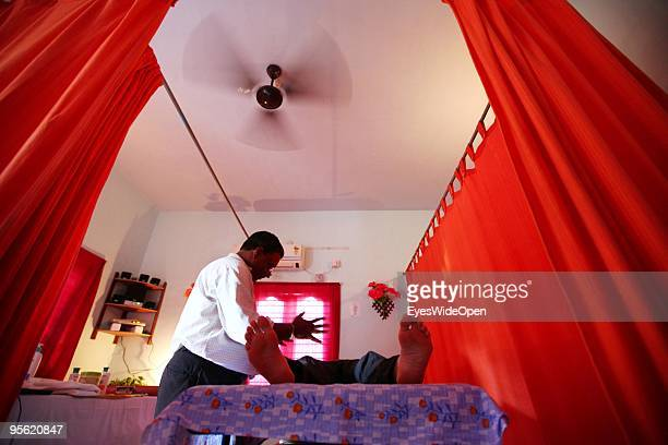 Reiki Master Sunil is giving energy for a body healing on December 20 2009 in Varkala near Trivandrum Kerala South India South india is famous for...