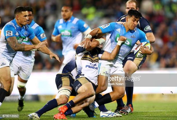Reiko Ioane of the Blues is tackled during the round 10 Super Rugby match between the Brumbies and the Blues at GIO Stadium on April 30 2017 in...
