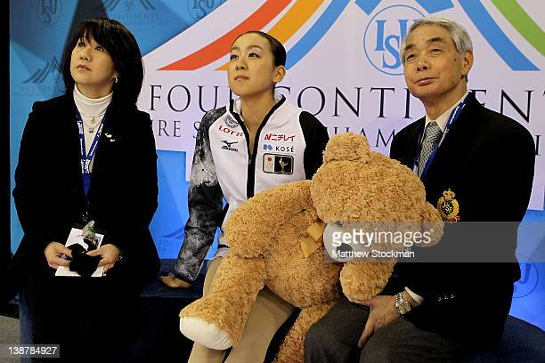 Reiko Kobayashi Mao Asada of Japan and her coach Nobuo Sato watch her scores after the Ladies Free Skate during the ISU Four Continents Figure...