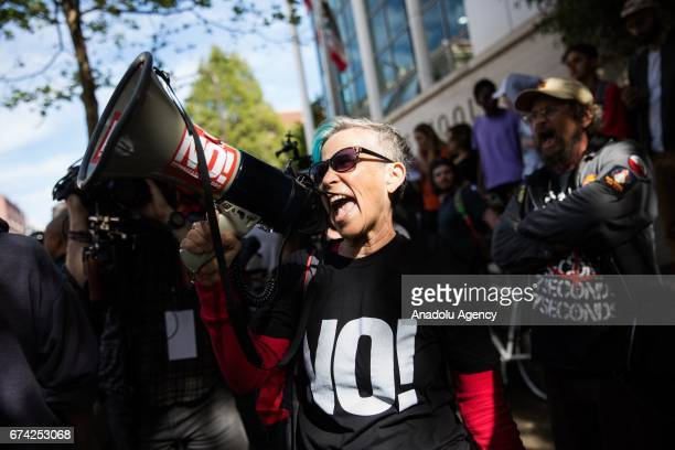 Reiko Redmond of Berkeley California addresses a group of Trump supporters across the road during a proDonald Trump rally at Martin Luther King Jr...