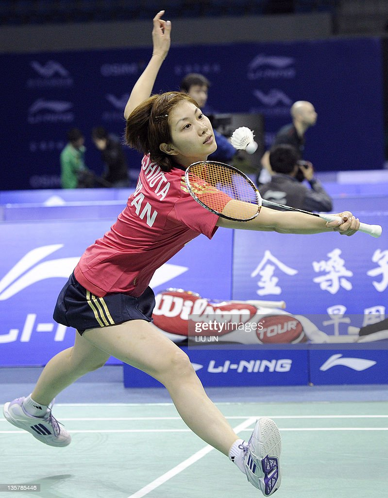 Reiko Shiota of Japan returns a shot wit