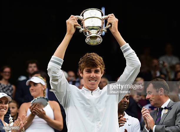 Reilly Opelka of the United States celebrates with the trophy after winning in the Final of the Boys Singles against Mikael Ymer of Sweden during day...