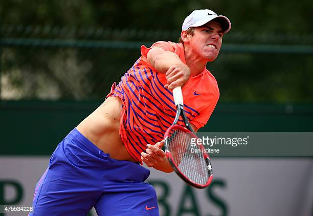 Reilly Opelka of the United States in action during his boys' singles match against Alvaro Lopez San Martin of Spain on day nine of the 2015 French...