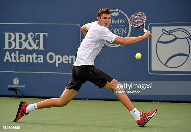 Reilly Opelka of the United States returns a shot to Christopher Eubanks of the United States during the BBT Atlanta Open at Atlantic Station on...