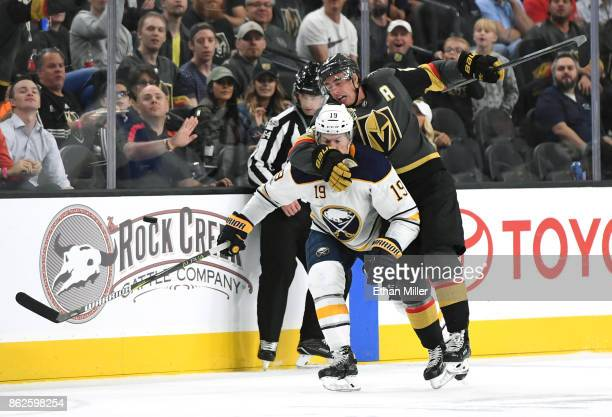 Reilly Smith of the Vegas Golden Knights hits Jake McCabe of the Buffalo Sabres as they chase the puck in the second period of their game at TMobile...