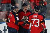 Reilly Smith celebrates his third period goal with Brandon Pirri and Vincent Trocheck of the Florida Panthers against the Edmonton Oilers at the BBT...