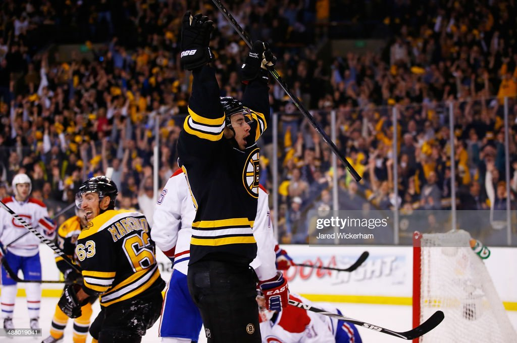 Reilly Smith of the Boston Bruins celebrates his gamewinning goal with teammate Brad Marchand in the third period against the Montreal Canadiens in...