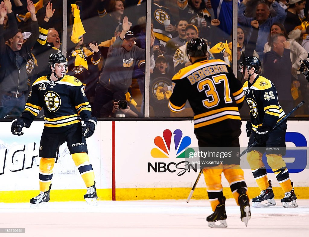 Reilly Smith #18 of the Boston Bruins celebrates his goal with teammates in the first period against the Detroit Red Wings during the game at TD Garden on April 20, 2014 in Boston, Massachusetts.