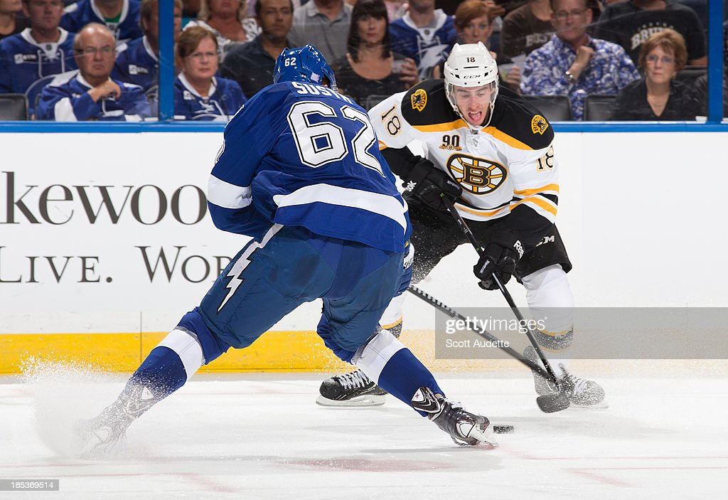 Reilly Smith #18 of the Boston Bruins controls the puck against Andrej Sustr #62 of the Tampa Bay Lightning during the second period at the Tampa Bay Times Forum on October 19, 2013 in Tampa, Florida.