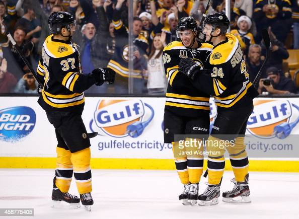 Reilly Smith of the Boston Bruins is congratulated by teammates Carl Soderberg and Patrice Bergeron after scoring a goal in the first period against...