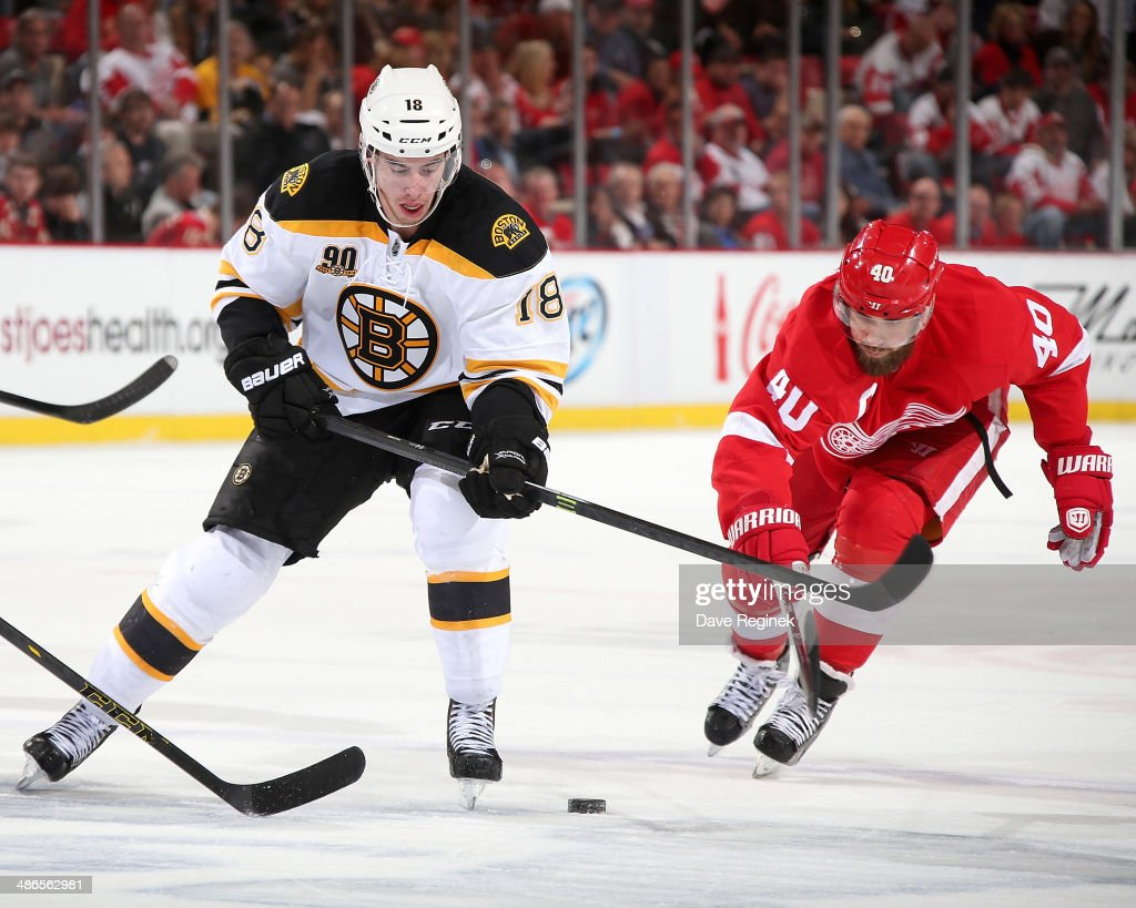 Reilly Smith #18 of the Boston Bruins skates with the puck as <a gi-track='captionPersonalityLinkClicked' href=/galleries/search?phrase=Henrik+Zetterberg&family=editorial&specificpeople=201520 ng-click='$event.stopPropagation()'>Henrik Zetterberg</a> #40 of the Detroit Red Wings pressures him during Game Four of the First Round of the 2014 Stanley Cup Playoffs on April 24, 2014 at Joe Louis Arena in Detroit, Michigan.