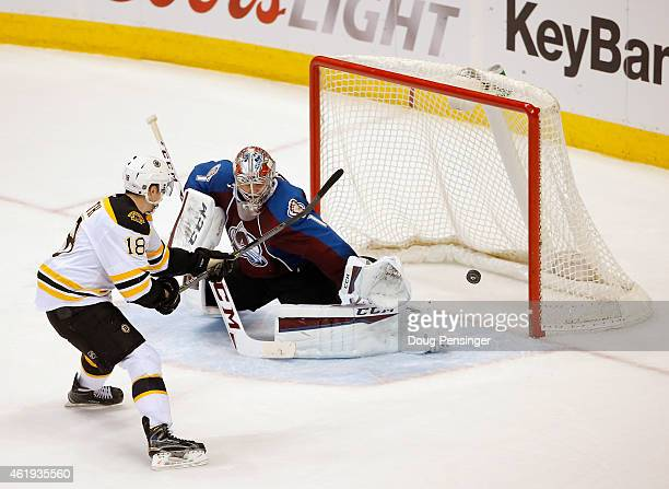 Reilly Smith of the Boston Bruins takes a shot wide agsinst goalie Semyon Varlamov of the Colorado Avalanche during an overtime shootout at Pepsi...