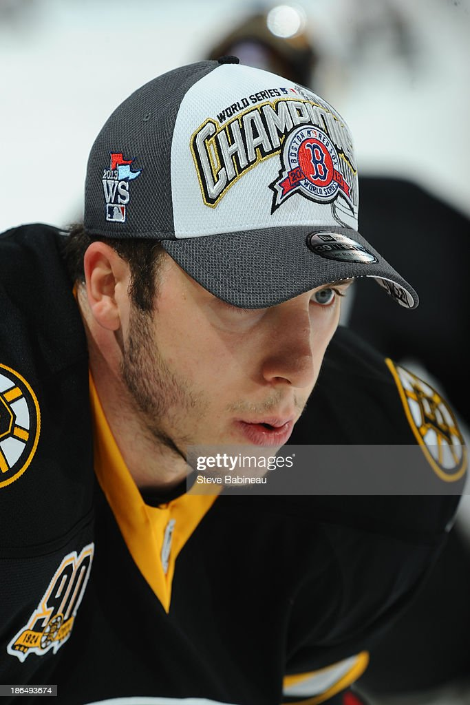 Reilly Smith #18 of the Boston Bruins wears a 2013 Red Sox World Seres Championship hat during warm ups prior to the game against the Anaheim Ducks at the TD Garden on October 31, 2013 in Boston, Massachusetts.