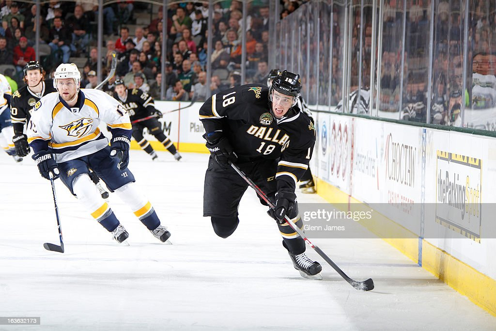 Reilly Smith #18 of the Dallas Stars handles the puck against <a gi-track='captionPersonalityLinkClicked' href=/galleries/search?phrase=Nick+Spaling&family=editorial&specificpeople=4112920 ng-click='$event.stopPropagation()'>Nick Spaling</a> #13 of the Nashville Predators at the American Airlines Center on March 12, 2013 in Dallas, Texas.