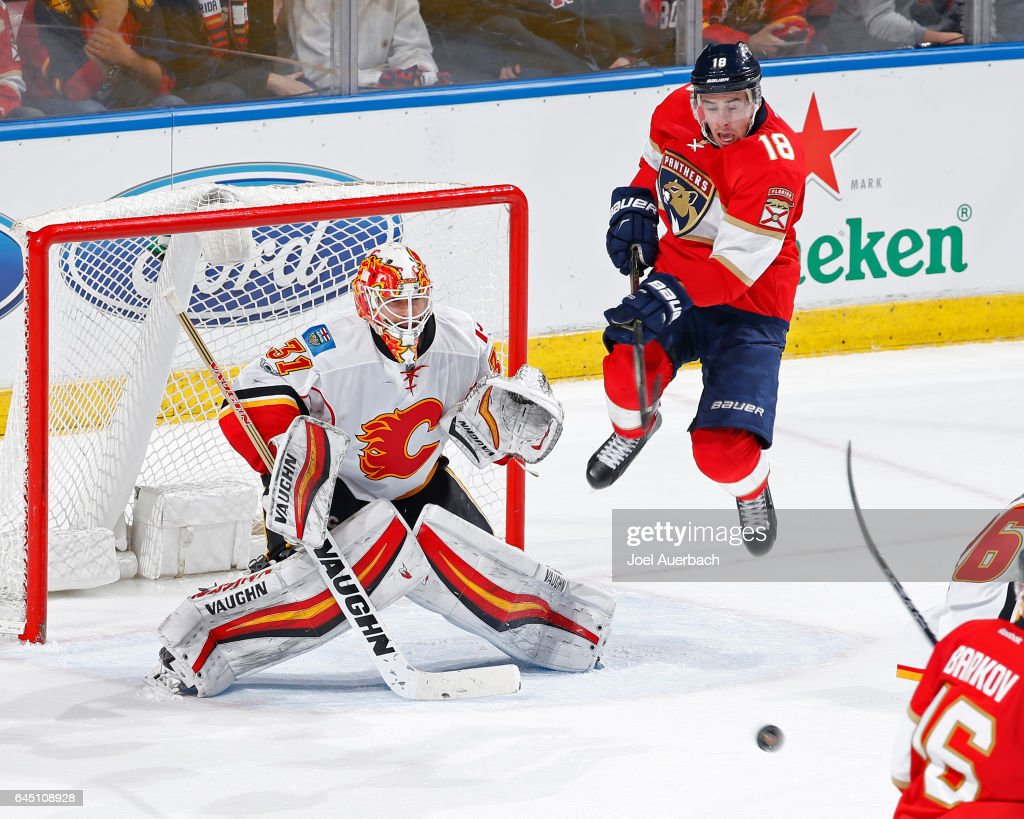 Reilly Smith #18 of the Florida Panthers jumps up in front of Goaltender Chad Johnson #31 of the Calgary Flames as the puck approaches the net during third period action at the BB&T Center on February 24, 2017 in Sunrise, Florida. The Flames defeated the Panthers 4-2.