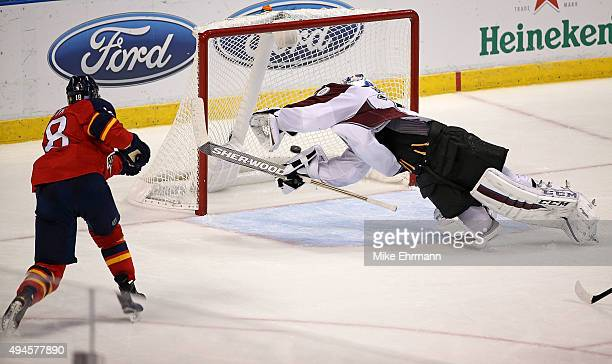 Reilly Smith of the Florida Panthers scores a goal on Reto Berra of the Colorado Avalanche during a game at BBT Center on October 27 2015 in Sunrise...
