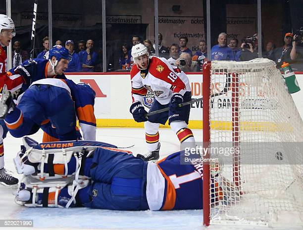 Reilly Smith of the Florida Panthers scores at 225 of the first period against Thomas Greiss of the New York Islanders during Game Three of the...