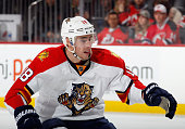 Reilly Smith of the Florida Panthers skates against the New Jersey Devils at the Prudential Center on December 17 2015 in Newark New Jersey The...