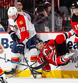 Reilly Smith of the Florida Panthers takes down Stephen Gionta of the New Jersey Devils on a bodycheck during the third period of an NHL hockey game...