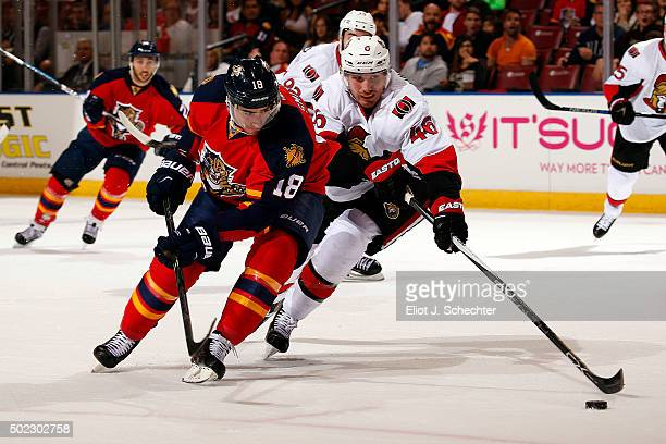 Reilly Smith of the Florida Panthers tangles with Patrick Wiercioch of the Ottawa Senators at the BBT Center on December 22 2015 in Sunrise Florida