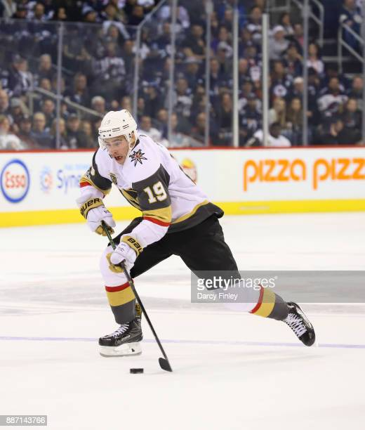 Reilly Smith of the Vegas Golden Knights plays the puck down the ice during third period action against the Winnipeg Jets at the Bell MTS Place on...