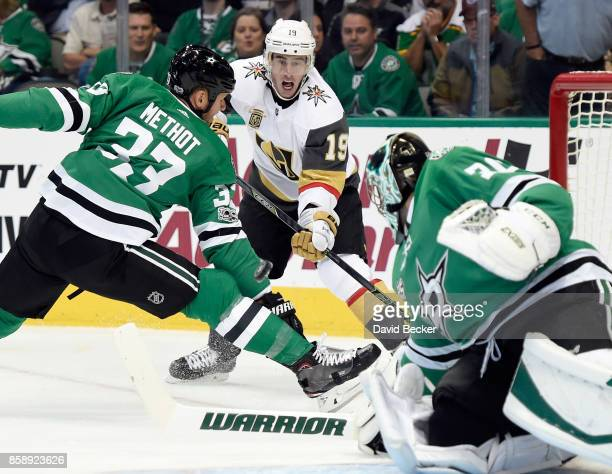 Reilly Smith of the Vegas Golden Knights shoots against Marc Methot and goalie Ben Bishop of the Dallas Stars during the season opening game at...